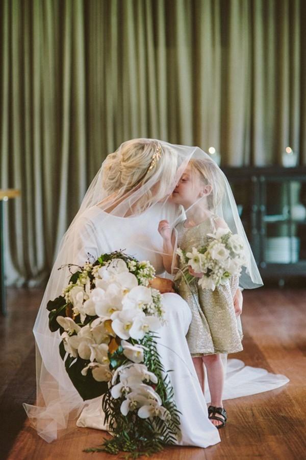 Bride Kissing Flowergirl