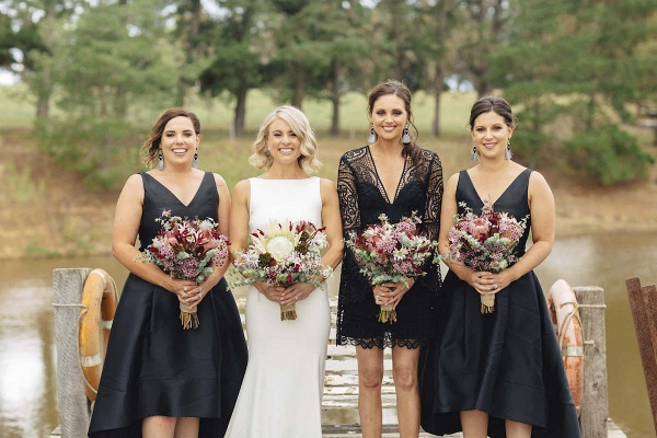 Bridesmaids In Mismatched Black Dresses