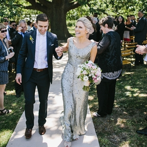 Newlyweds Recessional At Outdoor Wedding