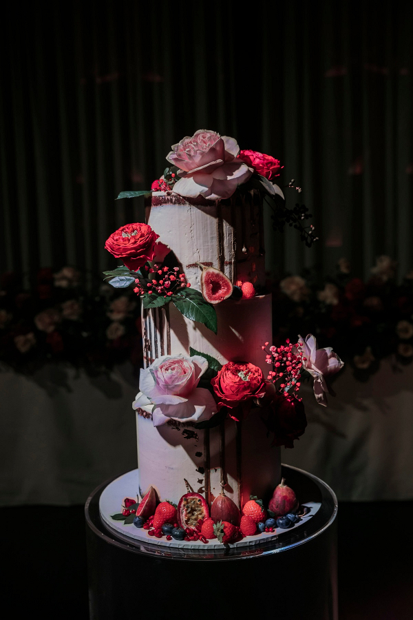 Modern pink drip wedding cake