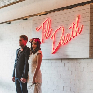 Neon Wedding Sign With Newlyweds