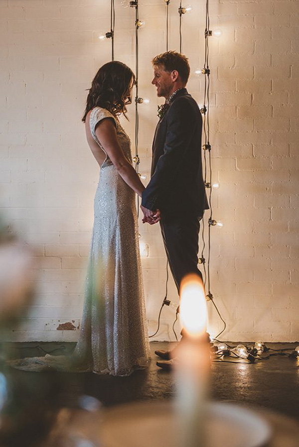 Newlyweds With Festoon Lights