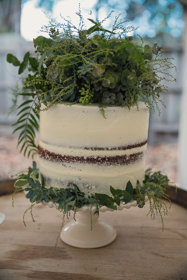 Semi Naked Wedding Cake With Greenery