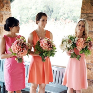 Bridesmaids In Peach & Pink Dresses