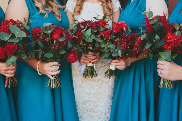 Red Bouquets With Teal Dresses
