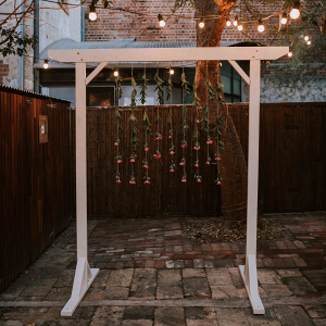 Nighttime ceremony with hanging flower arch