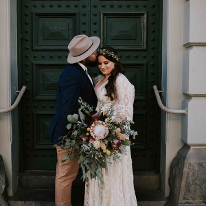 Boho bride and groom with oversized bouquet