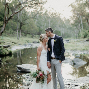 Wedding portrait by creek