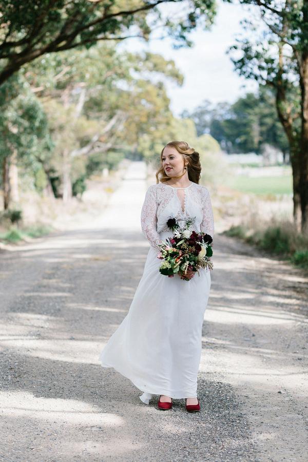 Bride Wearing Long Sleeve Gown