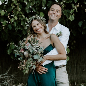 Bride in green wedding dress and floral crown