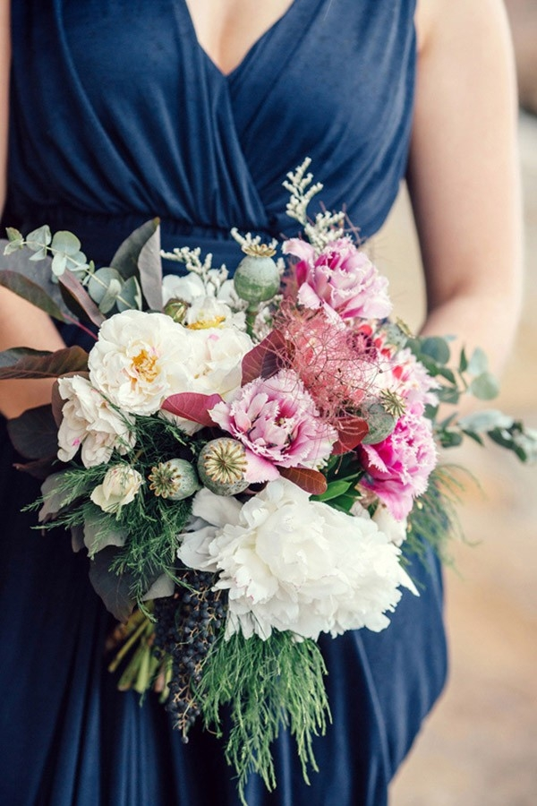 A Pink And Cream Bouquet With Peonies