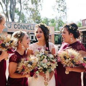 Bride With Bridesmaids In Marsala Dresses