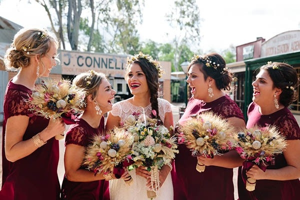 Bride With Bridesmaids In Marsala Dresses