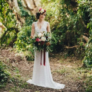 Elegant Bridal Gown With Marsala Bouquet