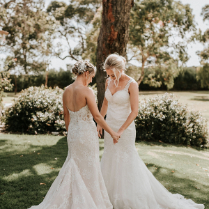 Two brides in lace wedding dresses