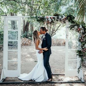 Bride and groom portrait with vintage door backdrop