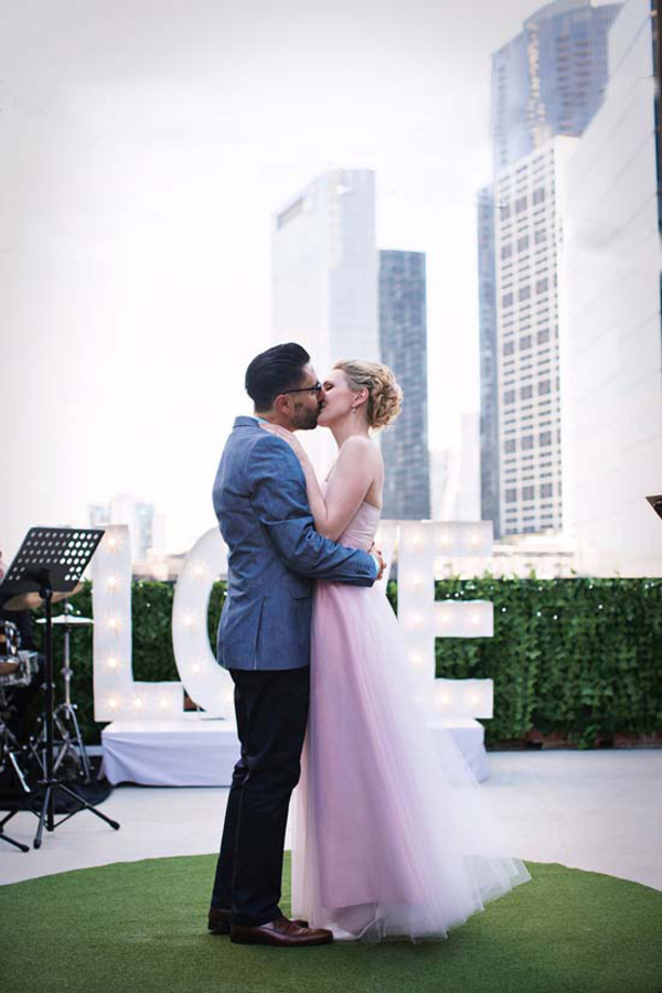 Rooftop Kiss from Bride and Groom
