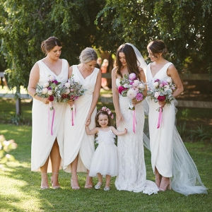 Bridesmaids With White Dresses And Pink Bouquets