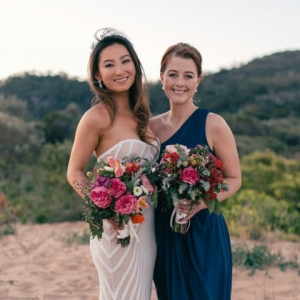 Bride With Bridesmaid On Palm Beach