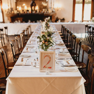 Long table wedding reception with DIY table numbers