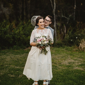 Vintage bride in tea length gown with groom