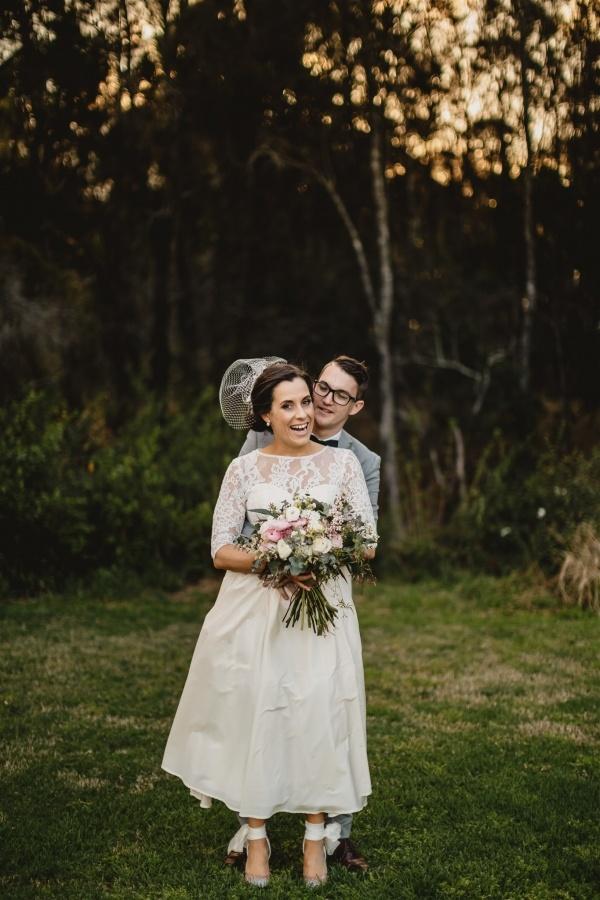 Vintage bride in tea length gown with groom