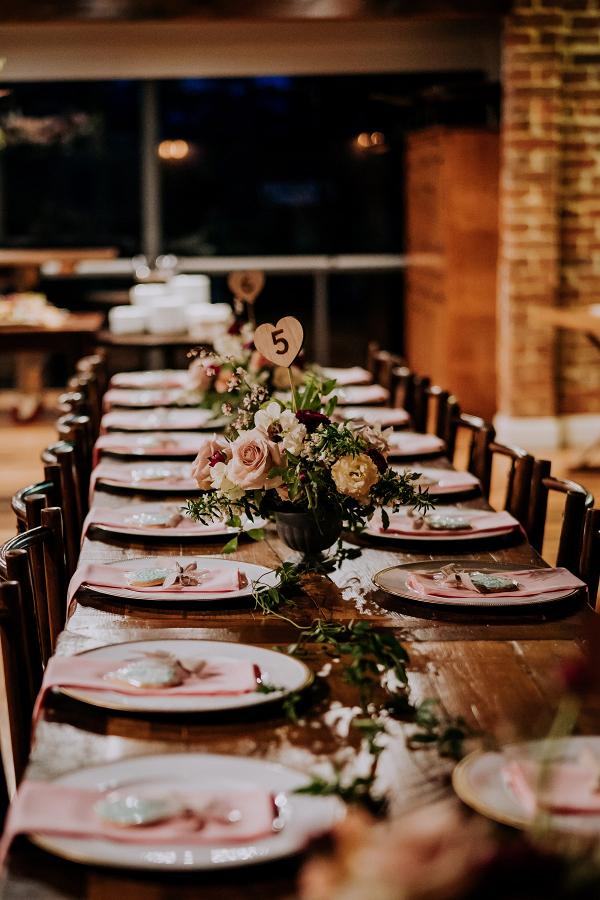 Rustic long table wedding reception
