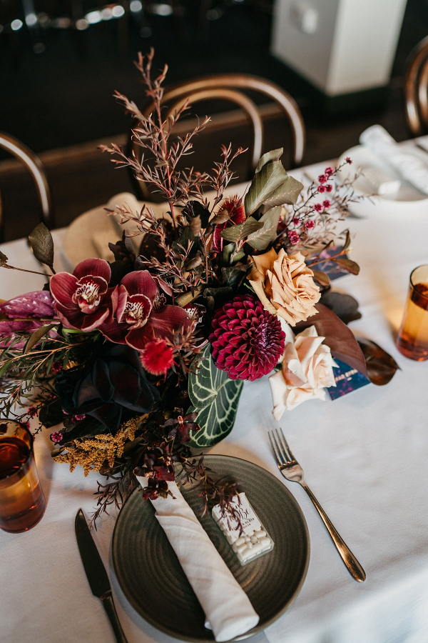 Indie wedding burgundy floral centerpiece