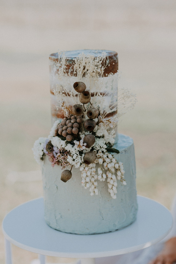 Semi naked wedding cake with dried flowers
