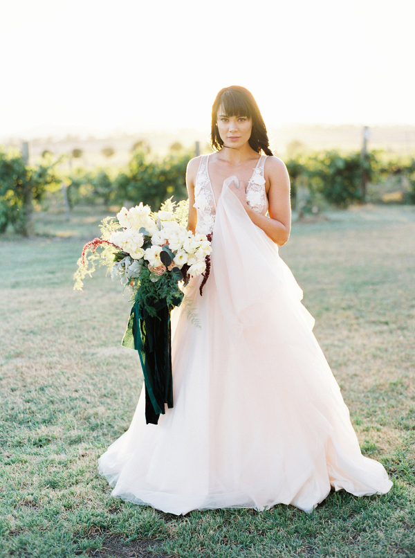 Bride At Country Wedding With Emerald Bouquet
