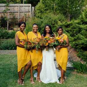 Bridesmaids in bright yellow hi-low dresses