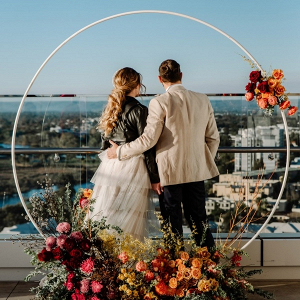 Floral circle arch rooftop wedding ceremony