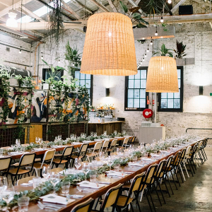 Long table wedding reception at warehouse