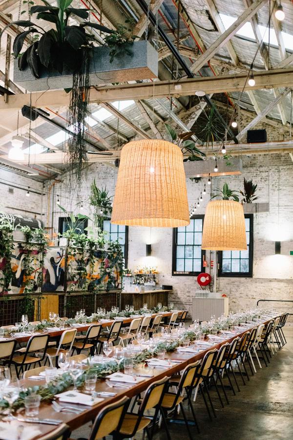 Long table wedding reception at warehouse
