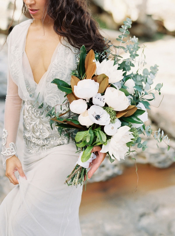 White bouquet with magnolia leaves