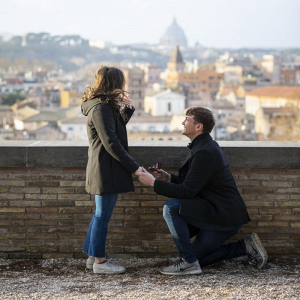 Rooftop proposal with urban Rome backdrop