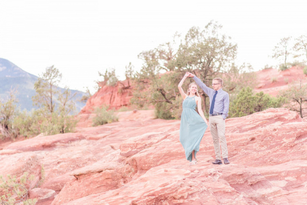 Posing on the rocks with the engagement rock