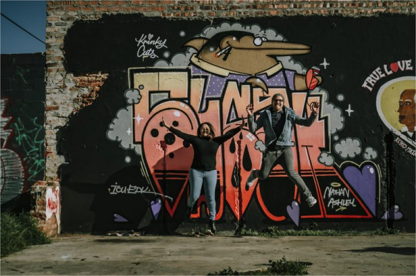 Jumping in front of the graffiti