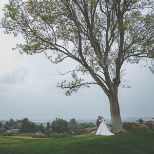 plus size bride, groom, under a tree