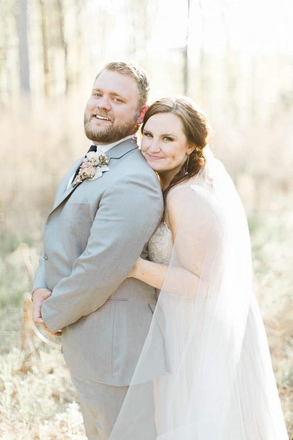 plus size bride, groom, grey suit, wedding veil, willowby by watters,