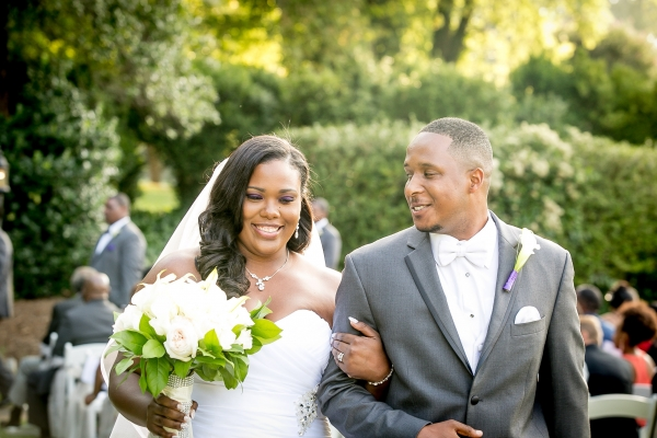 plus size bride with groom exiting from their cermony