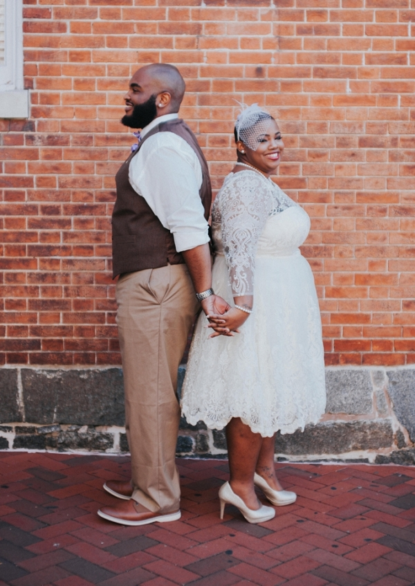 Plus size bride and her dapper groom in an intimate courthouse wedding in Annapolis