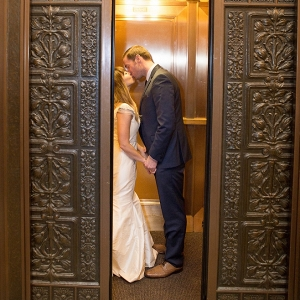 Bride and groom kissing in the elevator of the Carnegie Museum of Art!