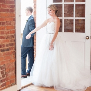 We're loving this super sweet first touch of the Bride and Groom in this darling DIY wedding!