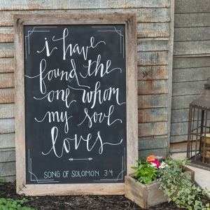 We love this darling hand lettered wedding ceremony sign at this sweet DIY wedding!