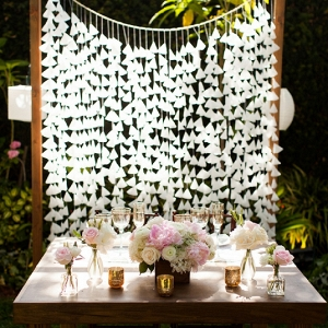 We're in LOVE with this Bride and Groom's beautiful handmade sweetheart table backdrop!