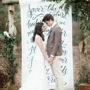 Check out this gorgeous hand lettered wedding ceremony backdrop!