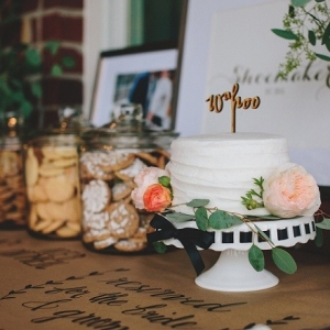 Darling little wedding cut cake and cookie bar!