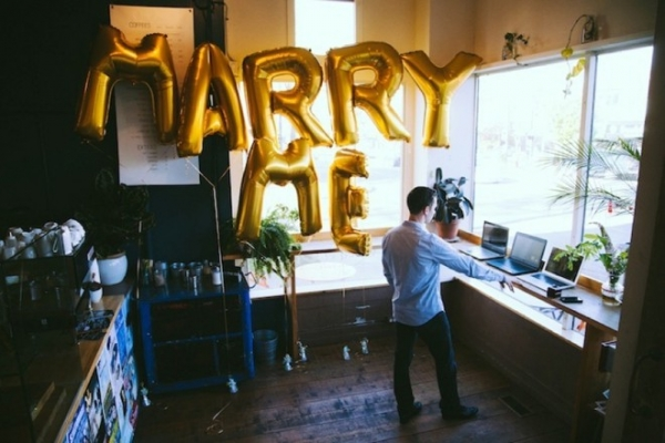 "Super sweet surprise proposal with giant ""marry me"" balloons!"