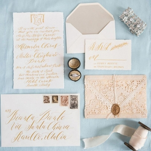 Gold calligraphy wedding invitation